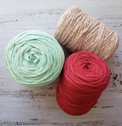 a group of tshirt yarn rolls