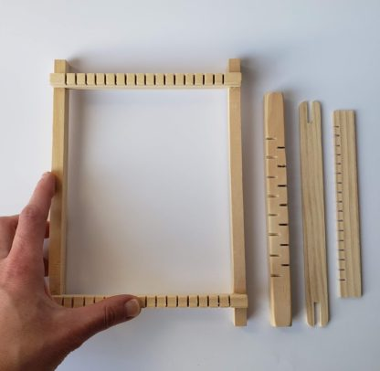 mini pine loom with hand for scale