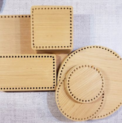 a collection of wooden basket bottoms for crochet